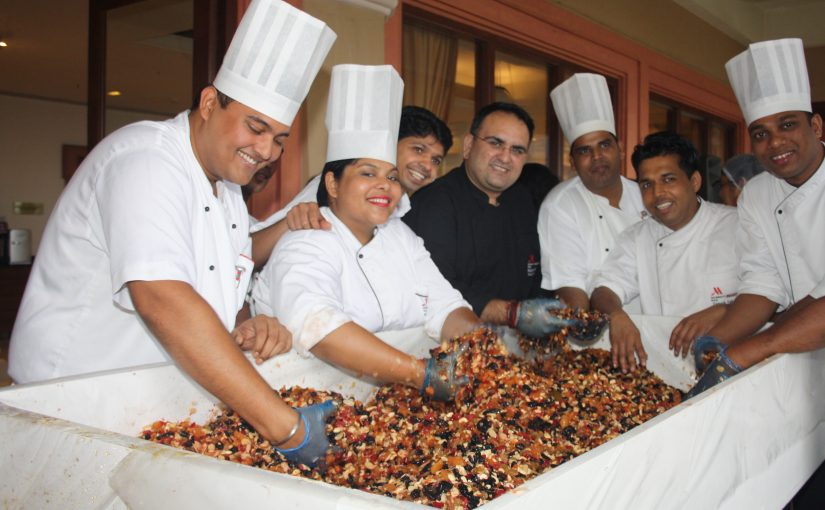 Cake mixing with staff at Goa Marriott Resort