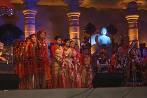 COLOURFUL TREAT: Against a sandstone mahal, a show of India's dances by a 500- strong troupe.