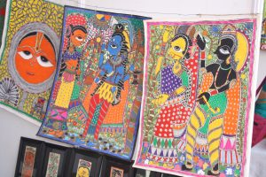 COLOURFUL: Buchidevi filling in her Madhubani paintings.