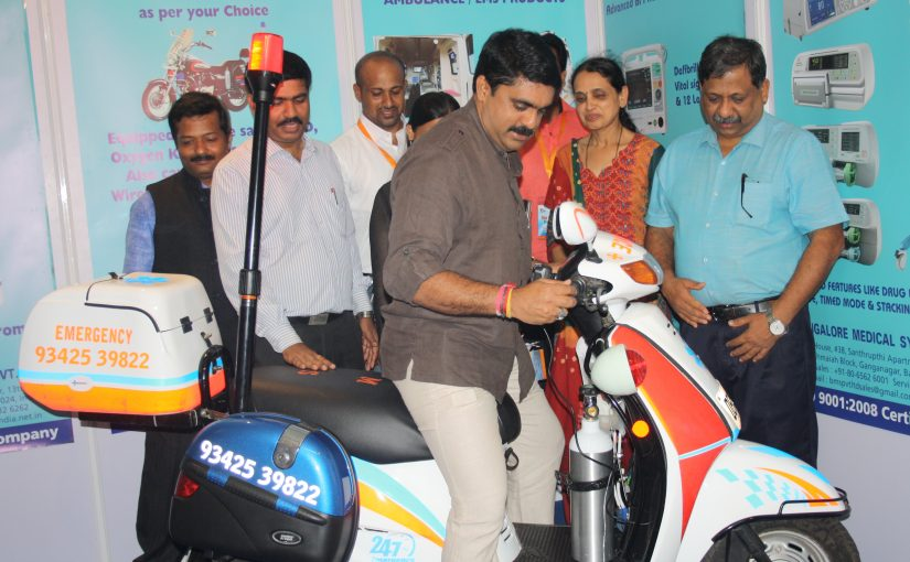 FASTER IN AN EMERGENCY? Minister for TCP & Agriculture Vijai Sardesai (Minister for TCP & Agriculture) checks out an RMS Bike Ambulance on exhibit at the IMA Health Expo at Goa Marriott Resort on May 26, 2017. Presumably, motorbike ambulances can get there faster to save a patient's life (late advocate Satish Sonak might be still alive). The bike ambulance comes equipped with ECG Monitor, Defibrillator, Syringe Pump, Suction Unit, N20=02 Cylinder for immediate pain relief, etc. Cost? Anybody's guess. Reportedly, mining company Vedanta has bought a couple!