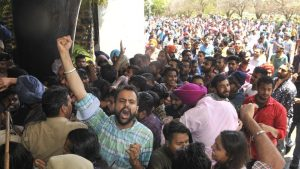 RALLY: Students of Punjab University protesting against action taken by the authorities against the topper who turned out to be 40 years old and was writing the exam for some other stud