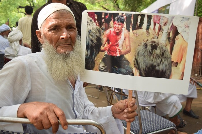 MUSLIM PROTESTERS DISMISS MODI